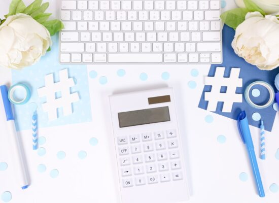 white and black calculator on white and blue textile